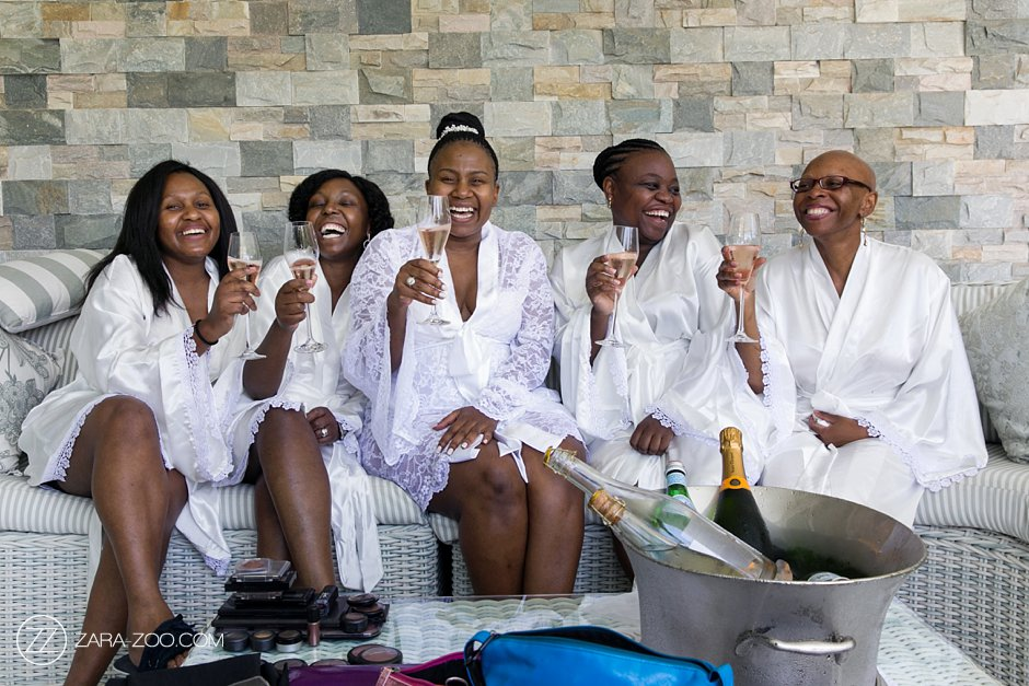 bridal party celebrating champagne