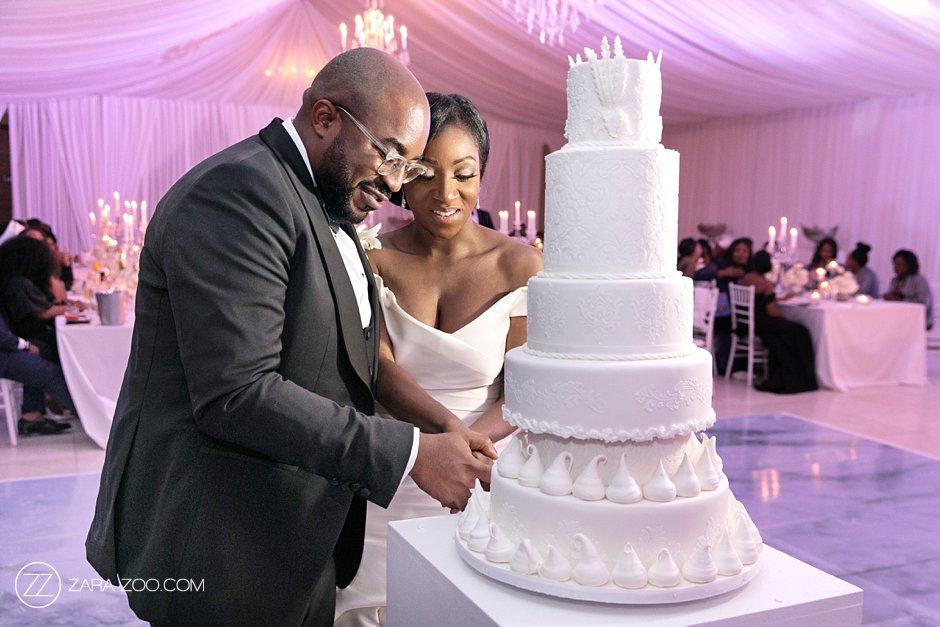 Couple Cutting Wedding Cake Photo